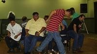 Good Sports -- the men in the midst of a hard fought musical chairs round.